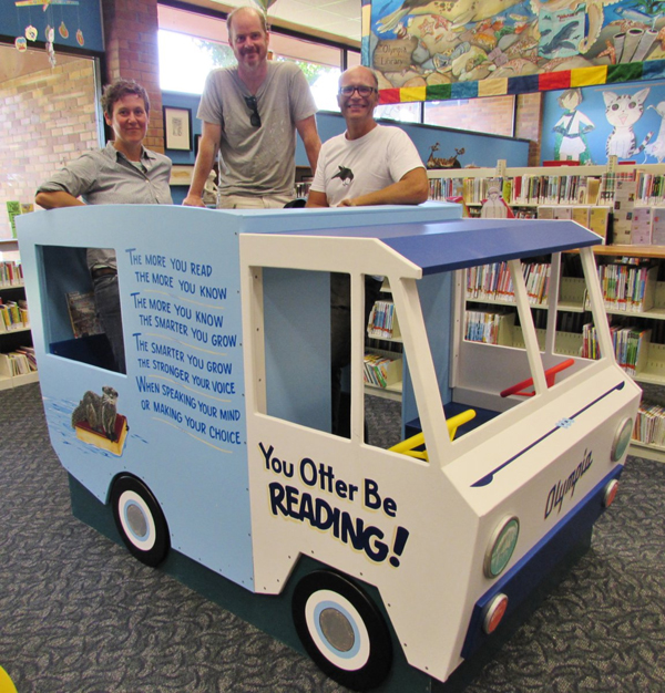 The new bookmobile with artists (from left to right) Nikki McClure, Ira Coyne and Jay T. Scott.
